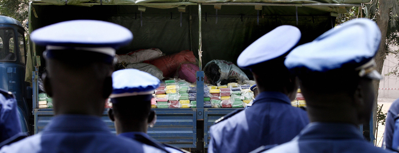 Gendarmes guard a truck with part of a seized cocaine haul at a cement furnace in Rufisque, near Dakar, August 2, 2007. (Georges Gobet/AFP/Getty Images)