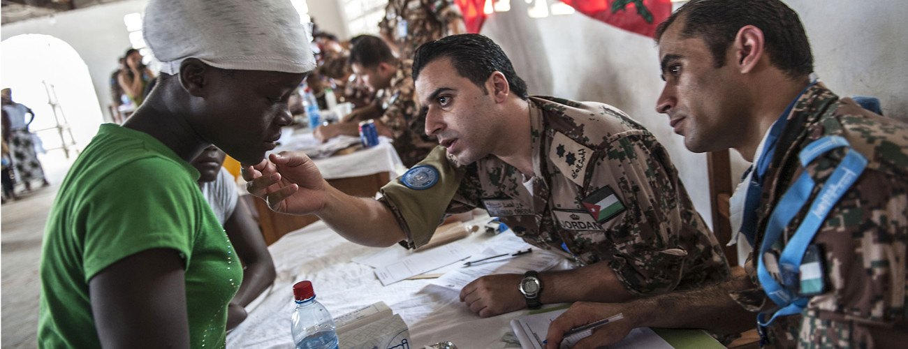 Jordanian doctors look at a young Liberian womans face during health check-ups as part of a medical outreach performed by the Jordanian Leve III Medical Group, at the Virginia Christian Acadamy outside of Monrovia center, on Saturday 15 December, 2012. (UN Photo/Staton Winter)