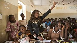 Students attend a class at a public school in Taliko, Bamako on October 24, 2013. UN Photo/Marco Dormino.