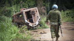 A MONUSCO peacekeeper walks towards the wreckage of a UN vehicle that was hit the previous year in an ambush by the Allied Democratic Forces rebel militia near Beni, Democratic Republic of the Congo on March 13, 2014. (UN Photo/Sylvain Leichti)