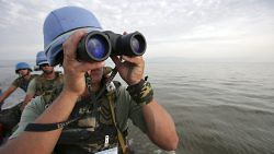 Uruguayan peacekeepers in the Democratic Republic of the Congo on a patrolling mission on Lake Albert, October 8, 2005.   (UN Photo/Martine Perret)