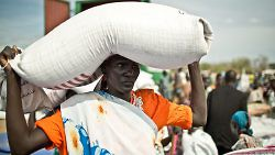 Woman receives a bag of food at an Oxfam distribution, Mingkaman, Southern Sudan, January 1, 2000. (Pablo Tosco/Oxfam)